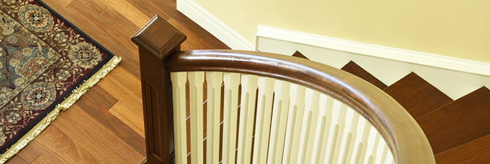 hardwood semi spiral staircase with cream bannisters